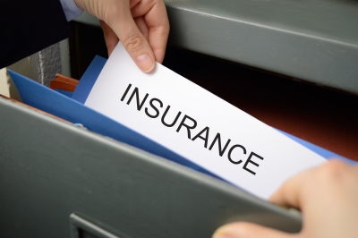 a woman seeking an insurance policy in a filing cabinet